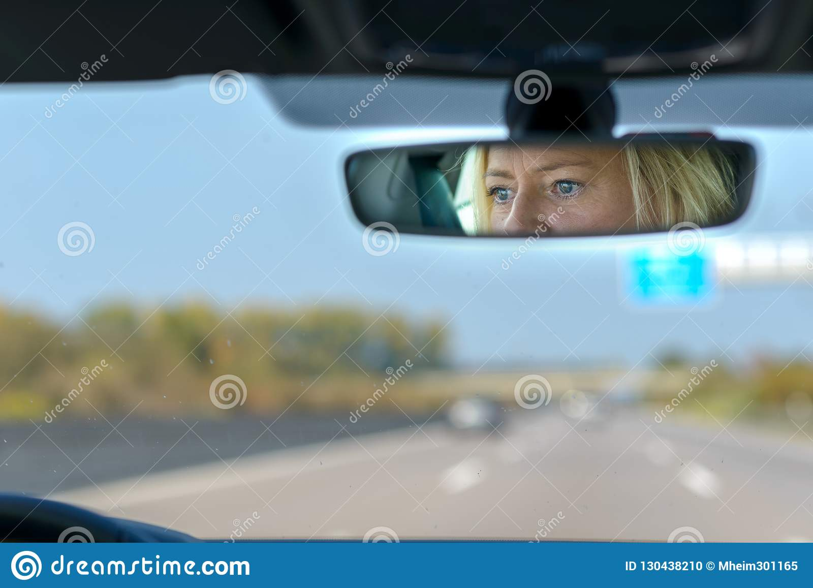 Woman driving a car on a motorway