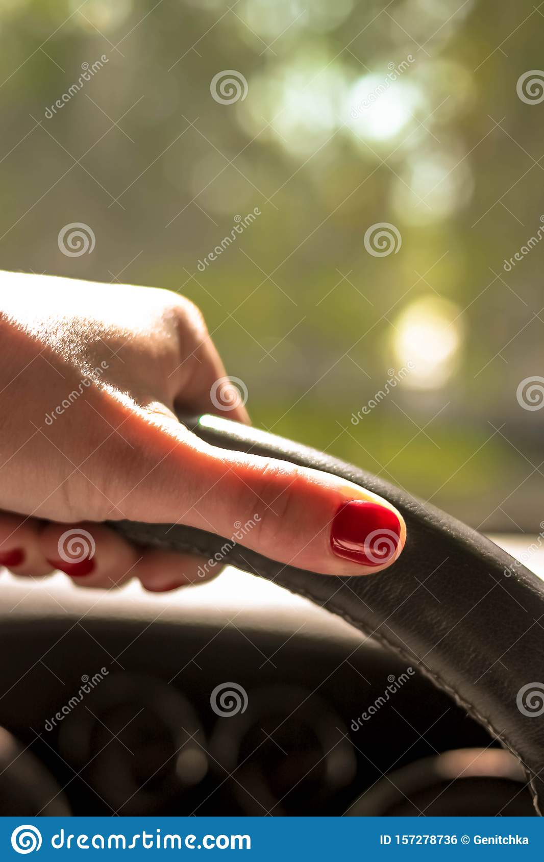 Woman Driving A Car With One Hand Holding The Steering Wheel Stock Photo Image Of Safety Nails 157278736