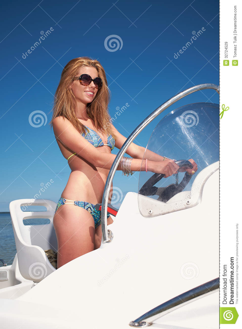 Woman Driving A Motor Boat Royalty Free Stock Images - Image: 32724529
