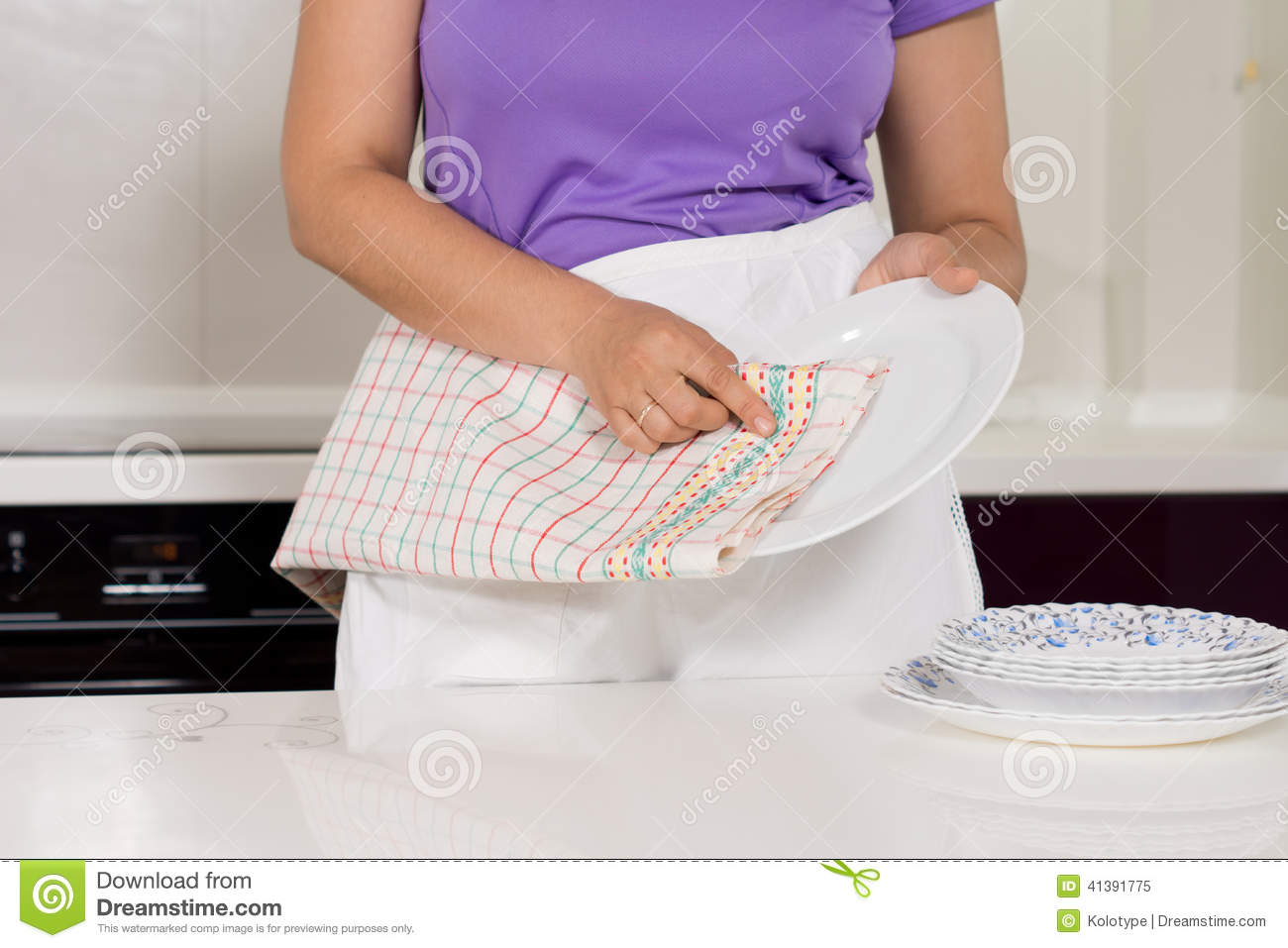 woman drying the dishes in the kitchen stock photo image 41391775. Black Bedroom Furniture Sets. Home Design Ideas