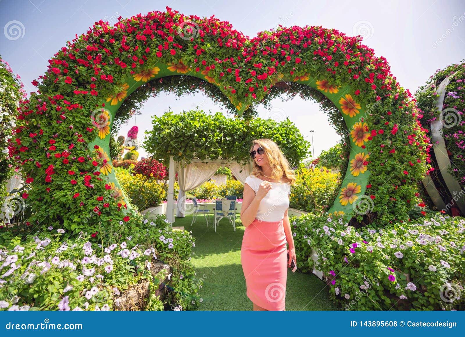 Woman In Dubai Garden Portrait Sunny Day Beautiful Flowers