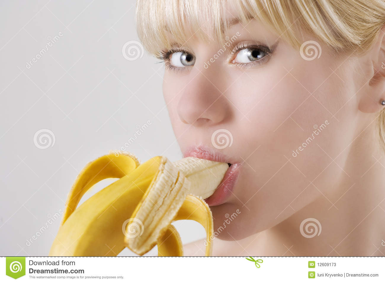 Woman Eating Banana Stock Photos - Image: 12609173