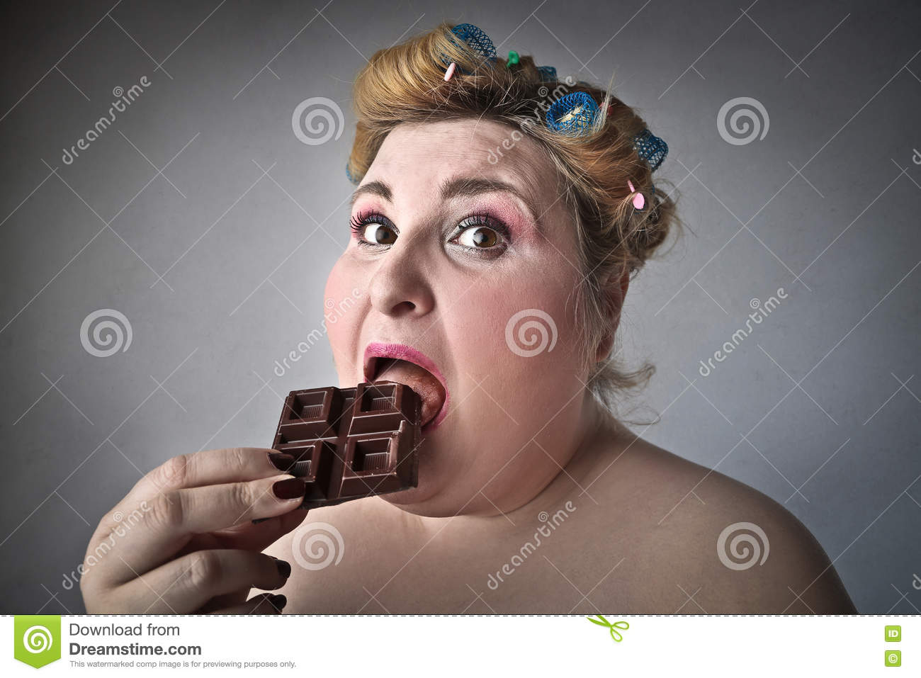Woman eating chocolate stock photo Image of hairstyle