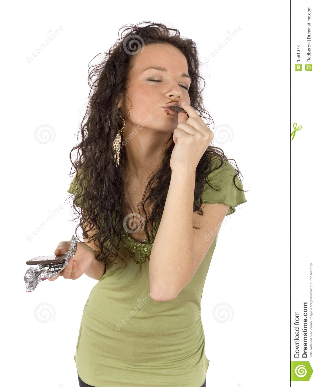 Woman eating chocolate with great pleasure