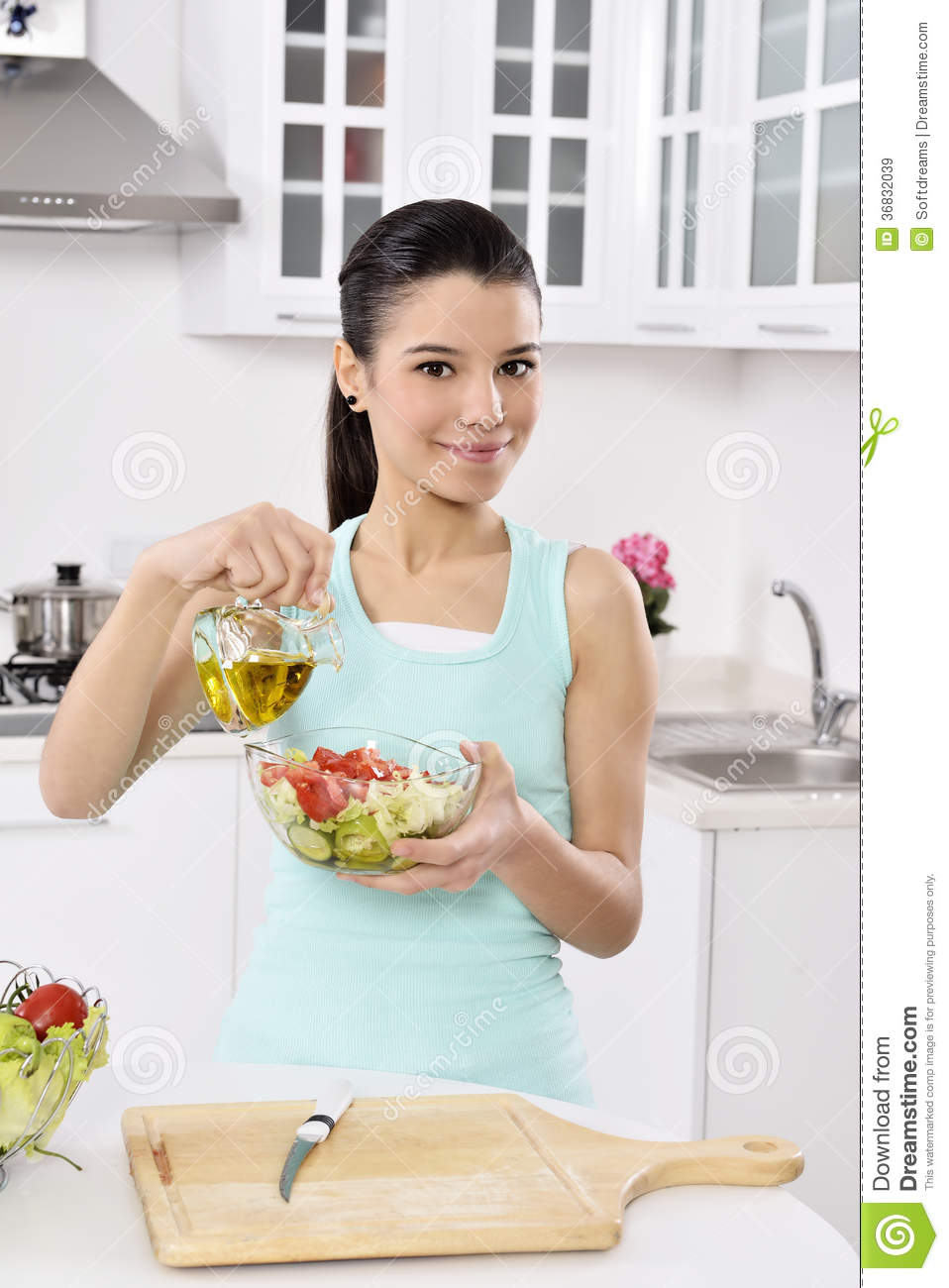 Beautiful Eat In Kitchens: Woman Eating Healthy Salad Royalty Free Stock Images