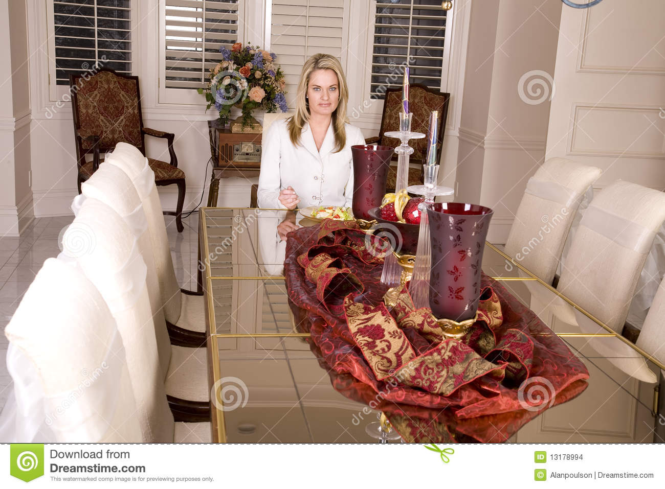 Woman Eating By Herself At Big Table Stock Photo Image