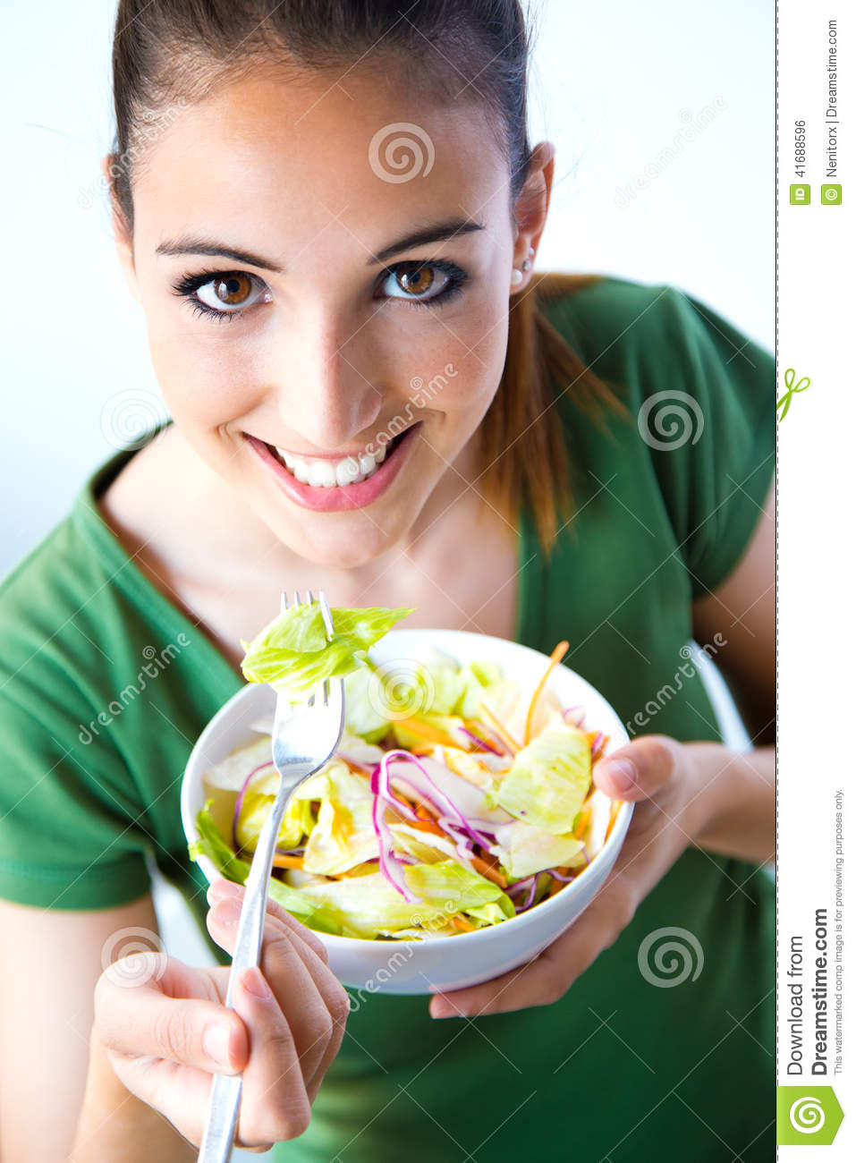 Portrait Of Happy Smiling Young Woman Eat Salad Stock