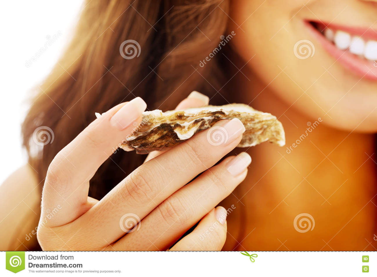 Woman eating shellfish.