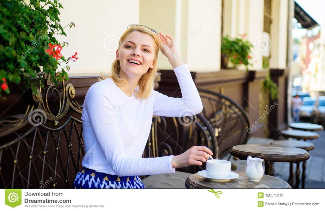 Woman elegant happy face have coffee cafe terrace outdoors. Mug of good coffee in morning gives me energy charge. Girl