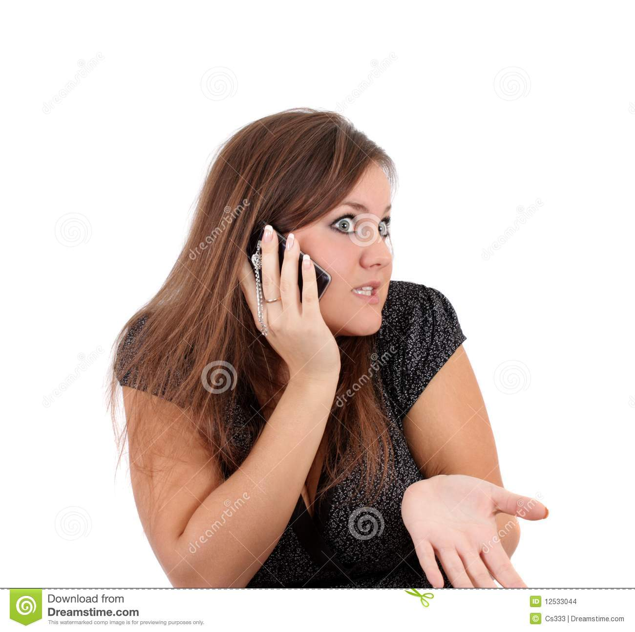 Woman emotionally speaks on the phone, isolated.