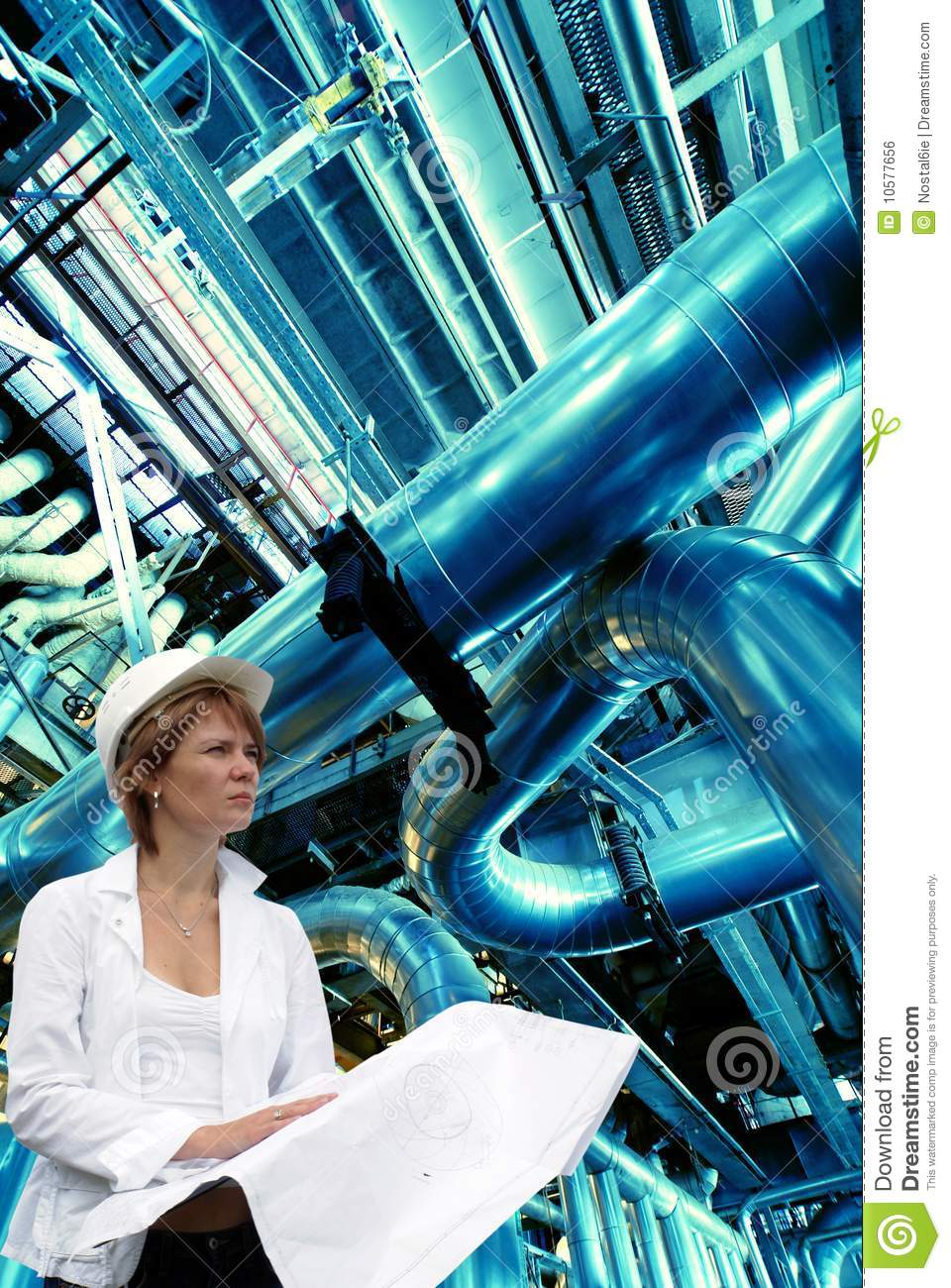 Woman engineer against pipes