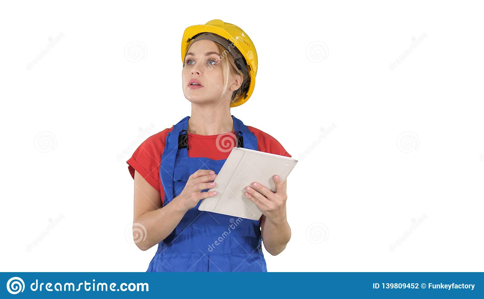 Woman engineer checking building plan on touchpad and looking at objects, buildings around her on white background.