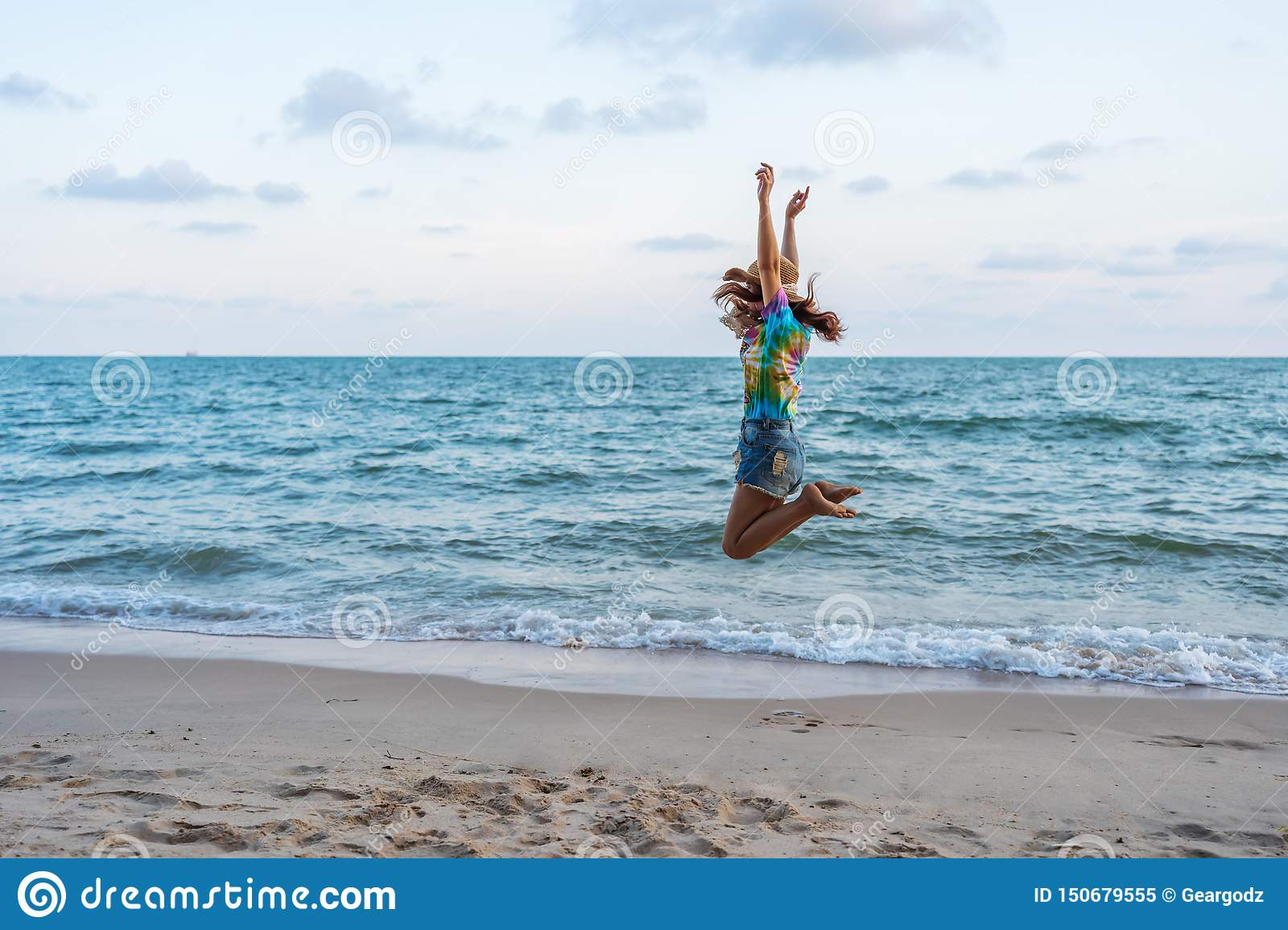Woman enjoy and jumping on sea beach