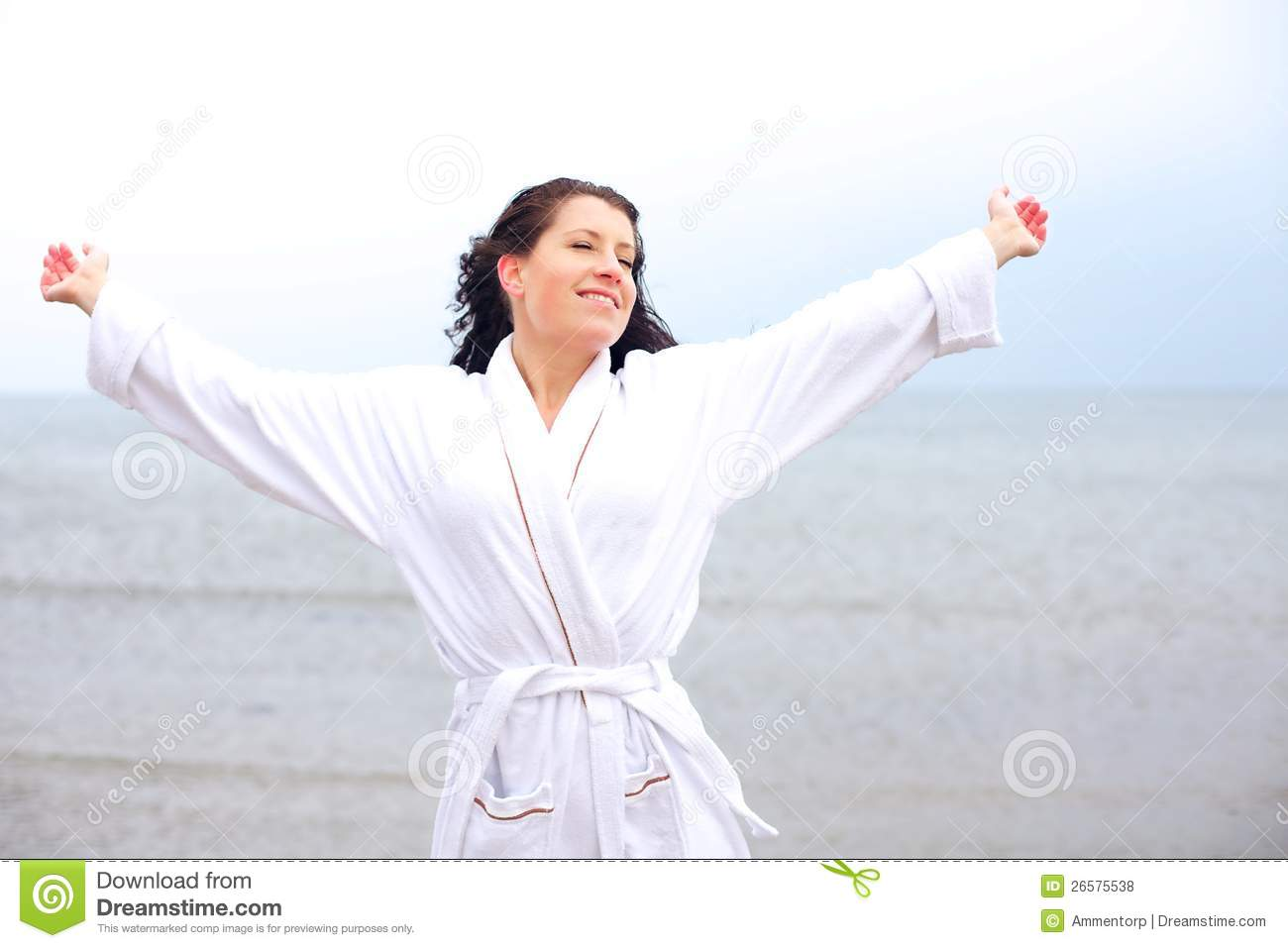 Woman Enjoying The Cool Fresh Air Of The Beach Stock Photo