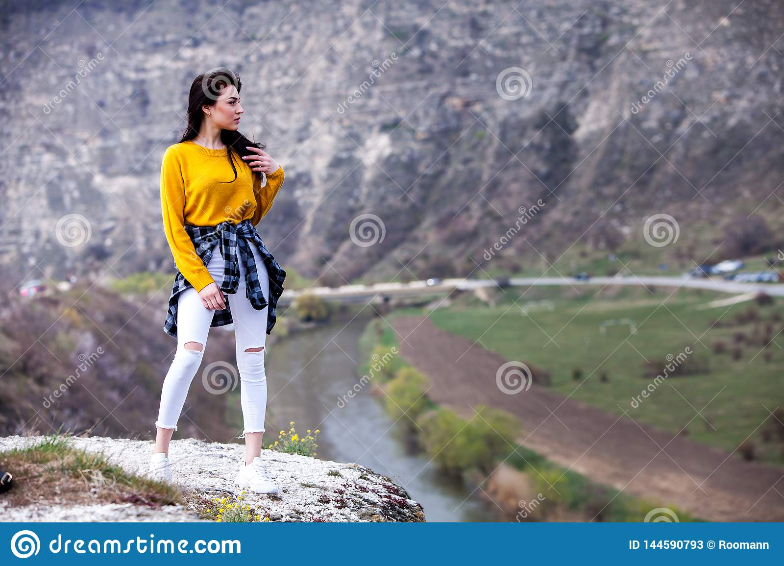 Woman Enjoying Nature. Travel and wanderlust concept Beautiful Young Woman Relaxing outdoors. Nature. Happy traveler girl