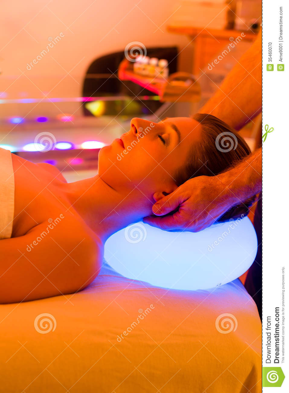 Woman Enjoying Therapy In Spa With Color Therapy Stock