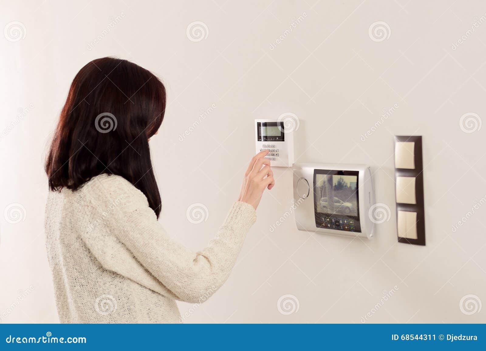 Woman Entering Code On Keypad Of Home Security Alarm Stock Image Burglar Circuit Working