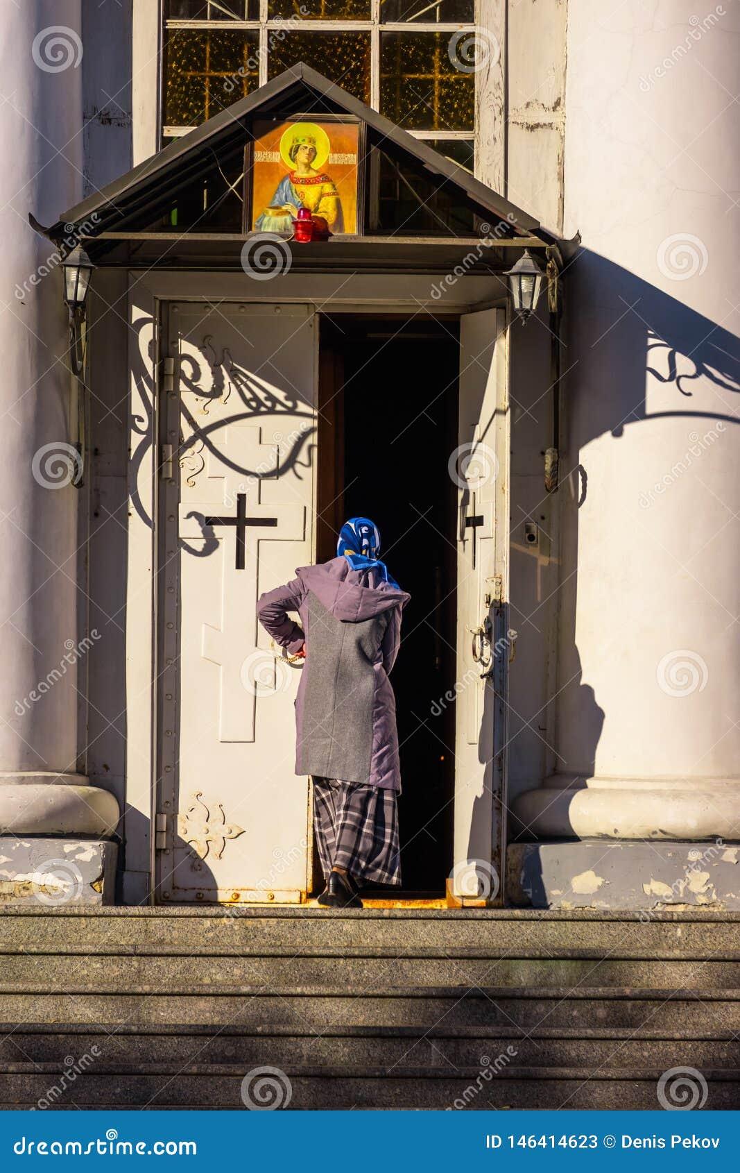 Woman enters church