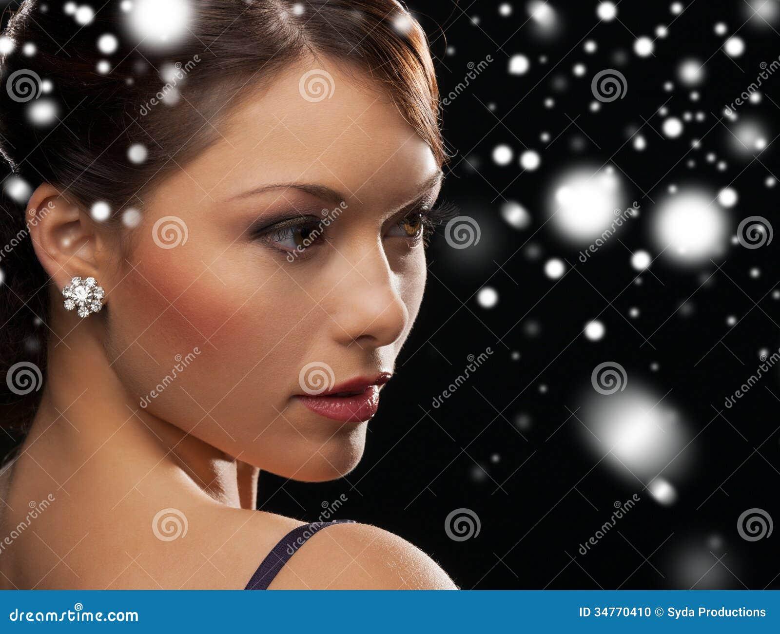 Woman In Evening Dress Wearing Diamond Earrings Stock ...