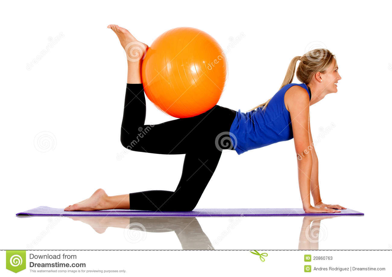 Sportive woman exercising with a Swiss ball - isolated.