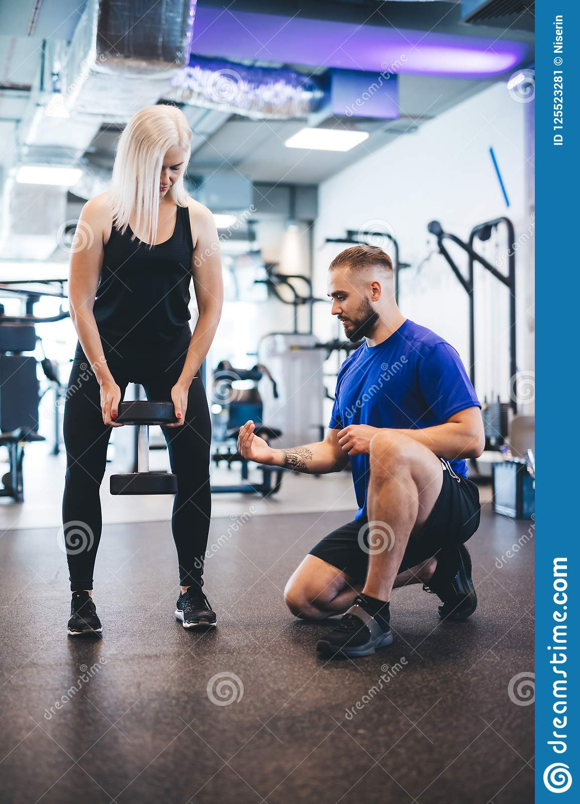 Woman exercising with personal trainer.