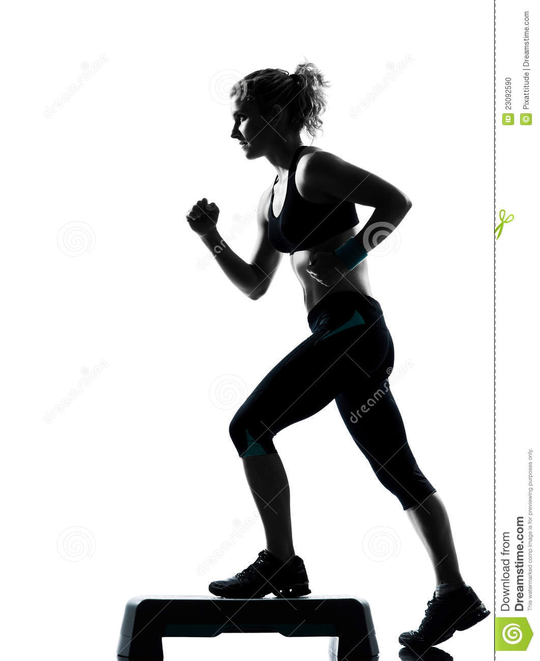 Woman Exercising Step Aerobics Stock Photo - Image: 23092590