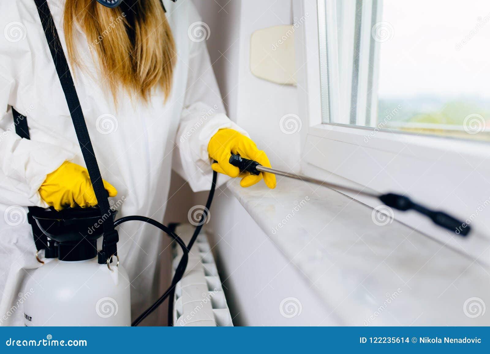 Woman exterminator working