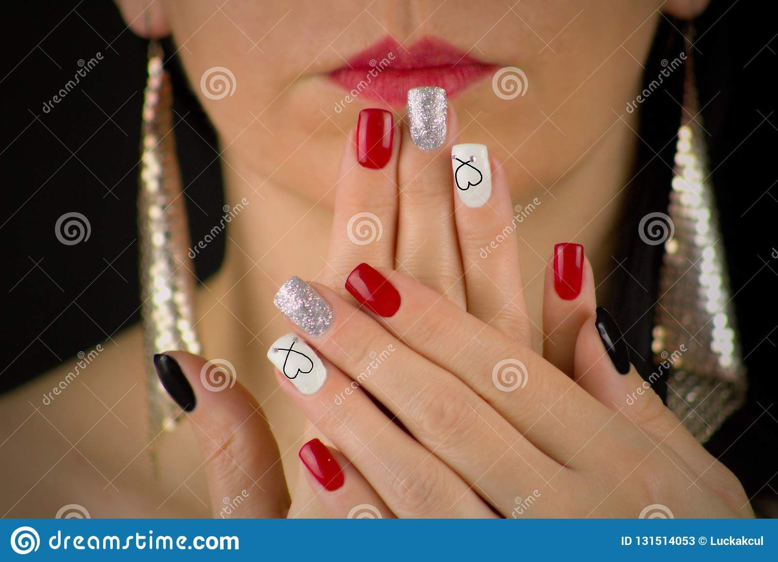 The Woman Has Red Black Glittering Silver And White Nails With Heart She Holds Her Palms In Front Of Her Face She Has Red Lips Stock Image Image Of Palms Lips 131514053