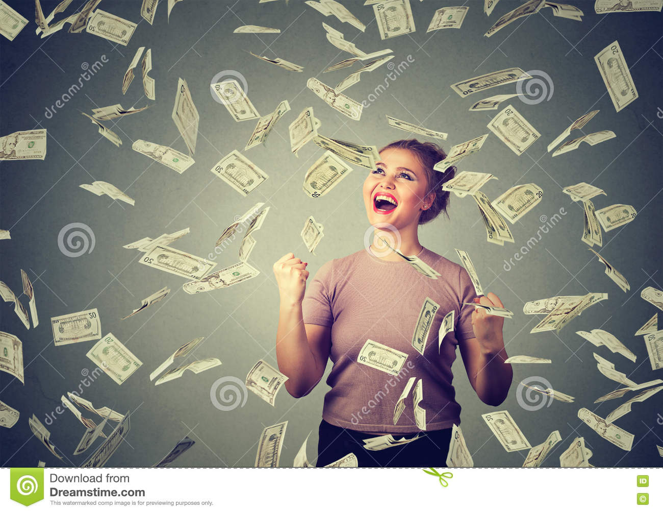 Woman exults pumping fists ecstatic celebrates success under money rain falling down dollar bills banknotes