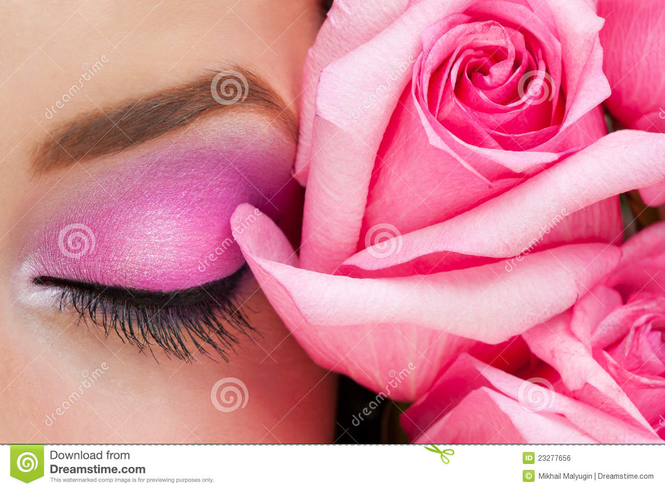 Woman eye with makeup and rose