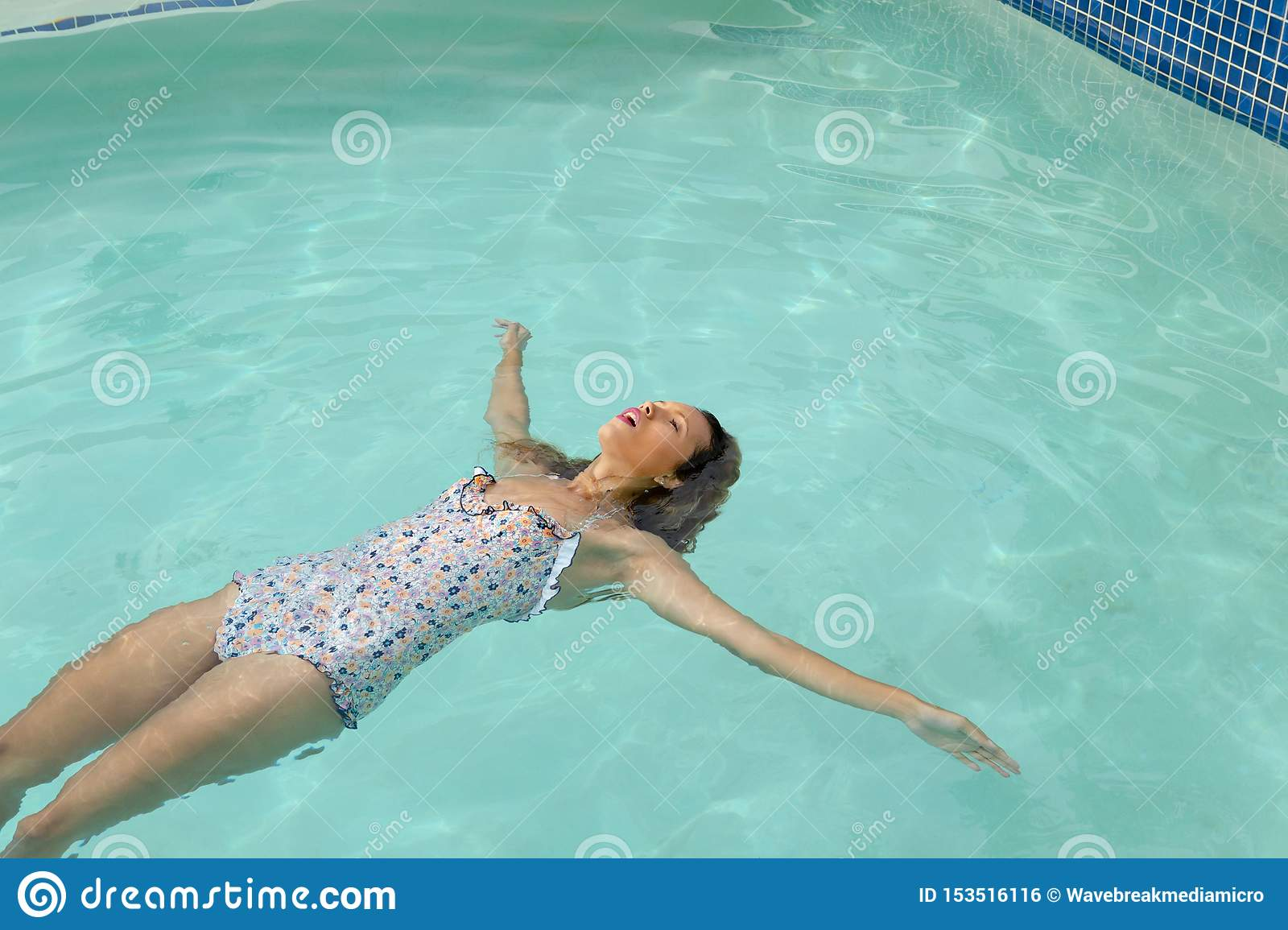 Woman With Eyes Closed Floating In Swimming Pool At The Backyard Of Home Stock Photo Image Of Carefree Outdoors 153516116