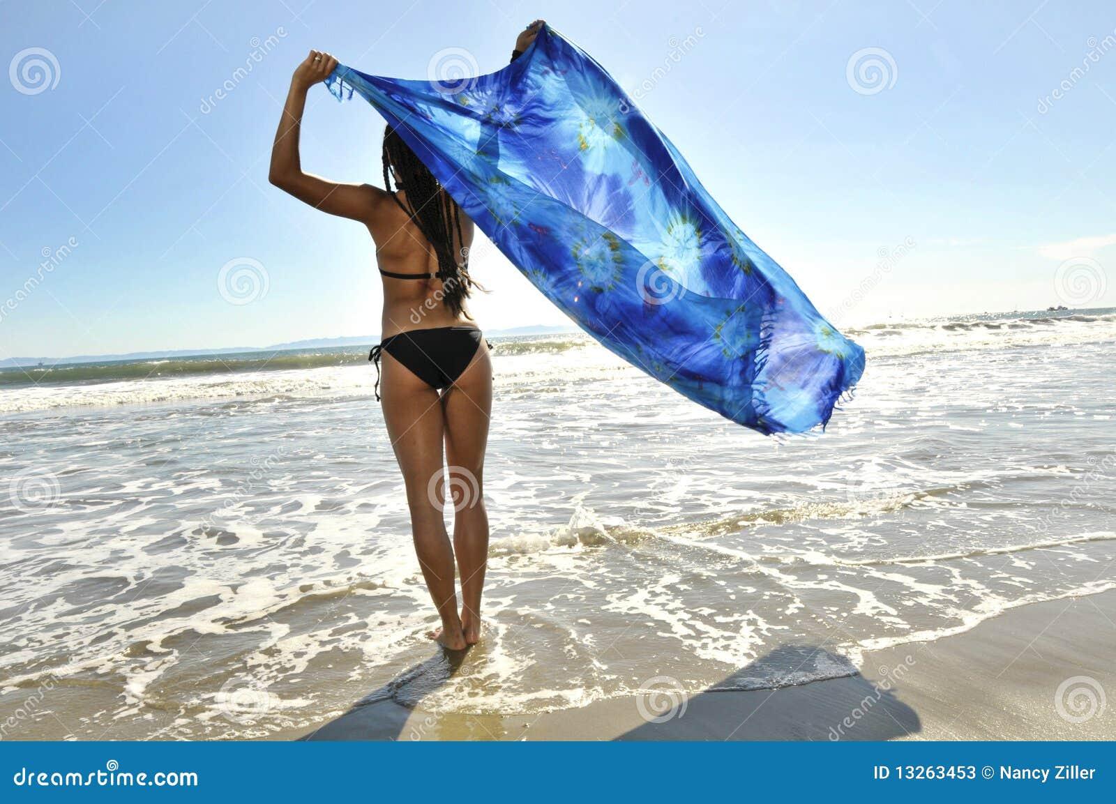 Woman Facing Ocean