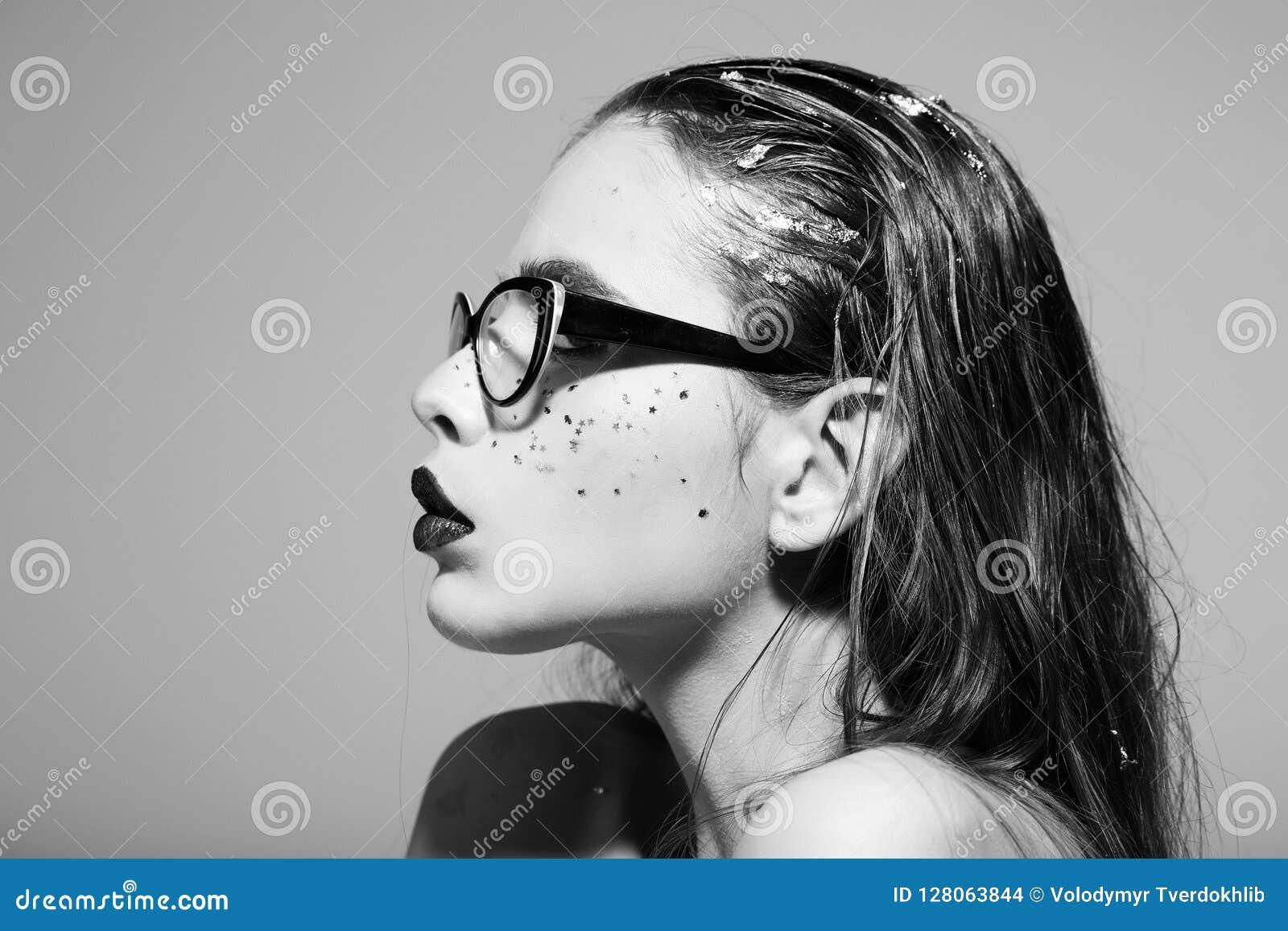 Woman with fashion makeup wearing eyeglasses