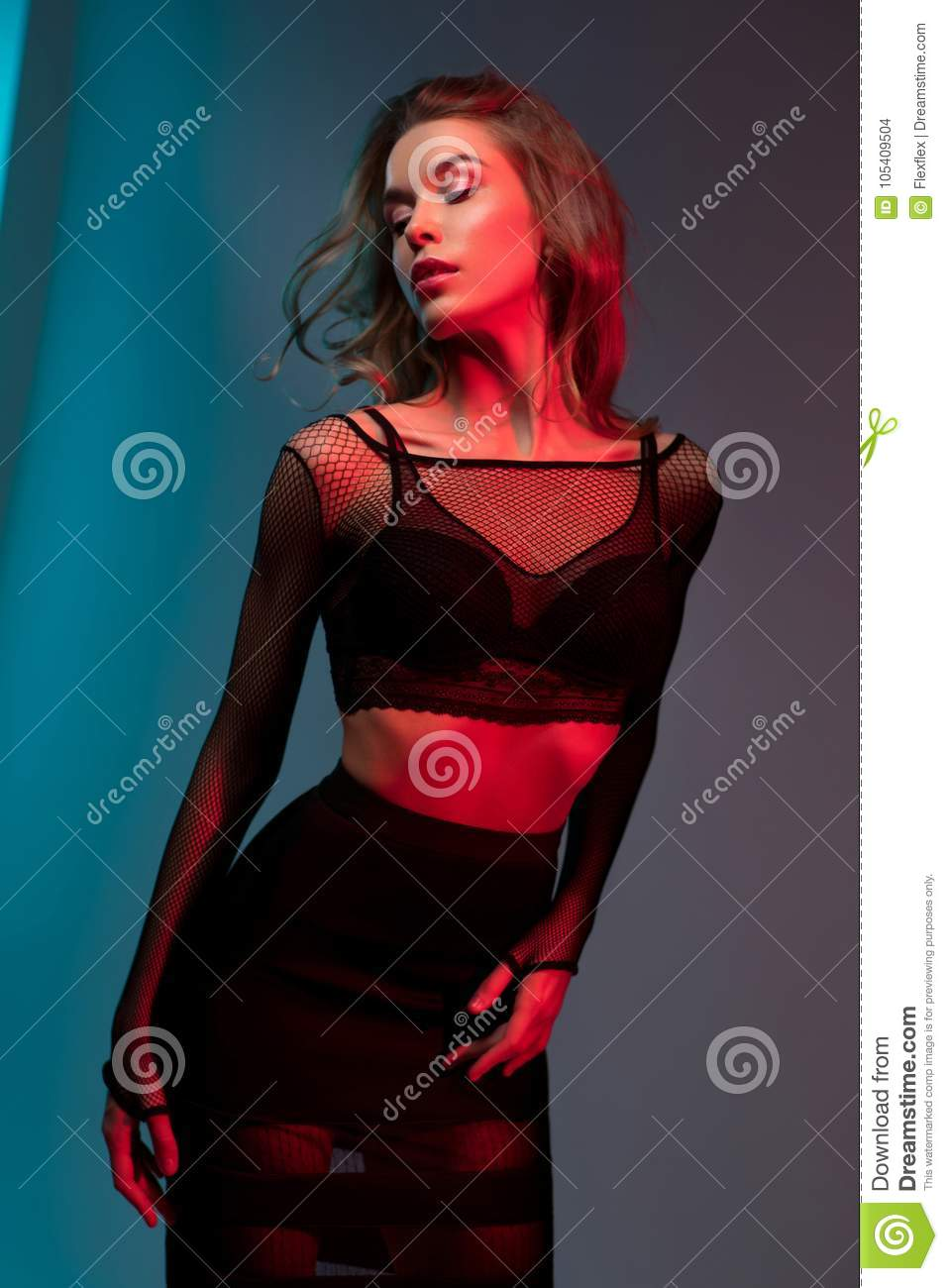 Woman in fashion top and skirt