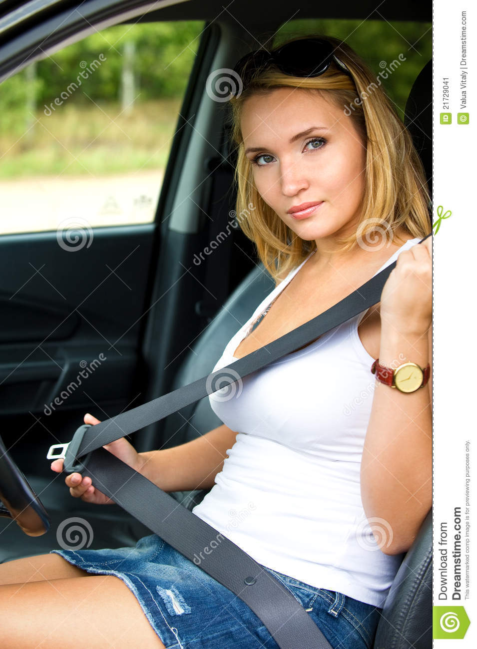 Woman Fastens A Seat Belt In Car Stock Image Image 21729041