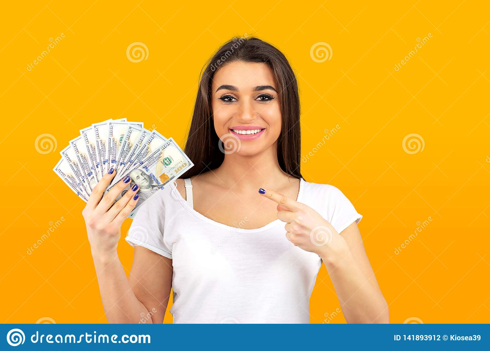 Woman feeling super happy holding fan of dollar money