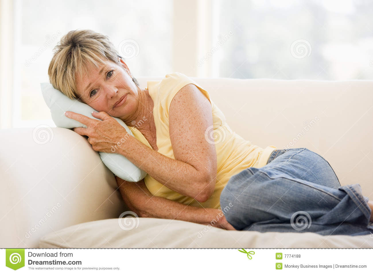 Woman feeling unwell on a sofa