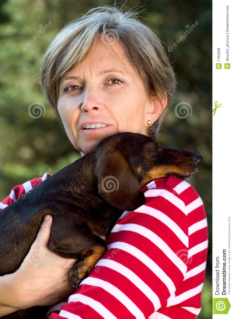 Woman in fifties holding a dog