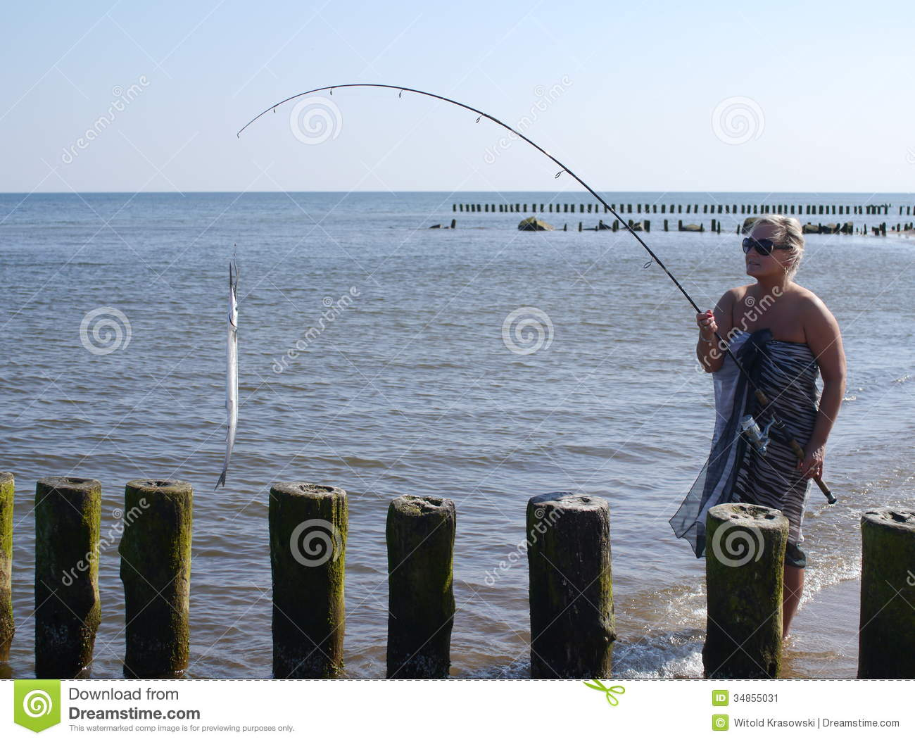 woman with fish and fishing-rod stock image - image: 34855031, Fishing Rod