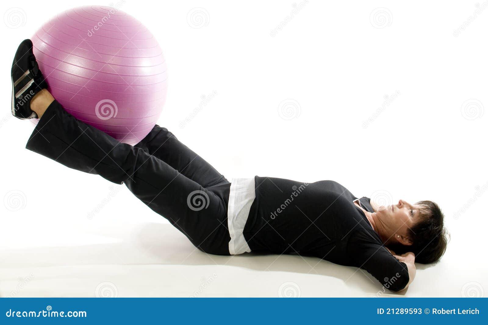 Woman fitness exercise leg raise training ball
