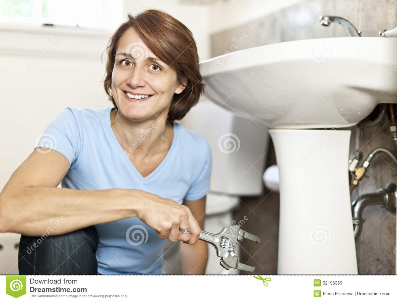 Woman Fixing Plumbing Royalty Free Stock Images Image