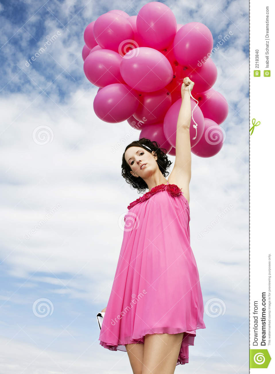 woman flying with pink balloons stock photo