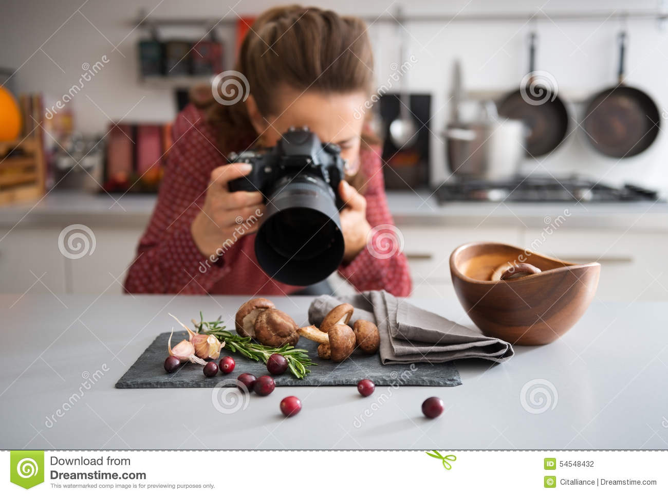 Woman food photographer taking closeup of mushrooms Stock Photography. Closeup On Female Food Photographer Taking Photo Stock Photo