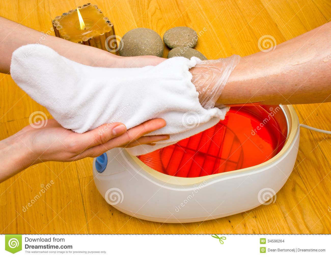 Woman Foot In Paraffin Bath At The Spa Stock Photo - Image: 34596264 for Paraffin Wax Foot Bath  239wja