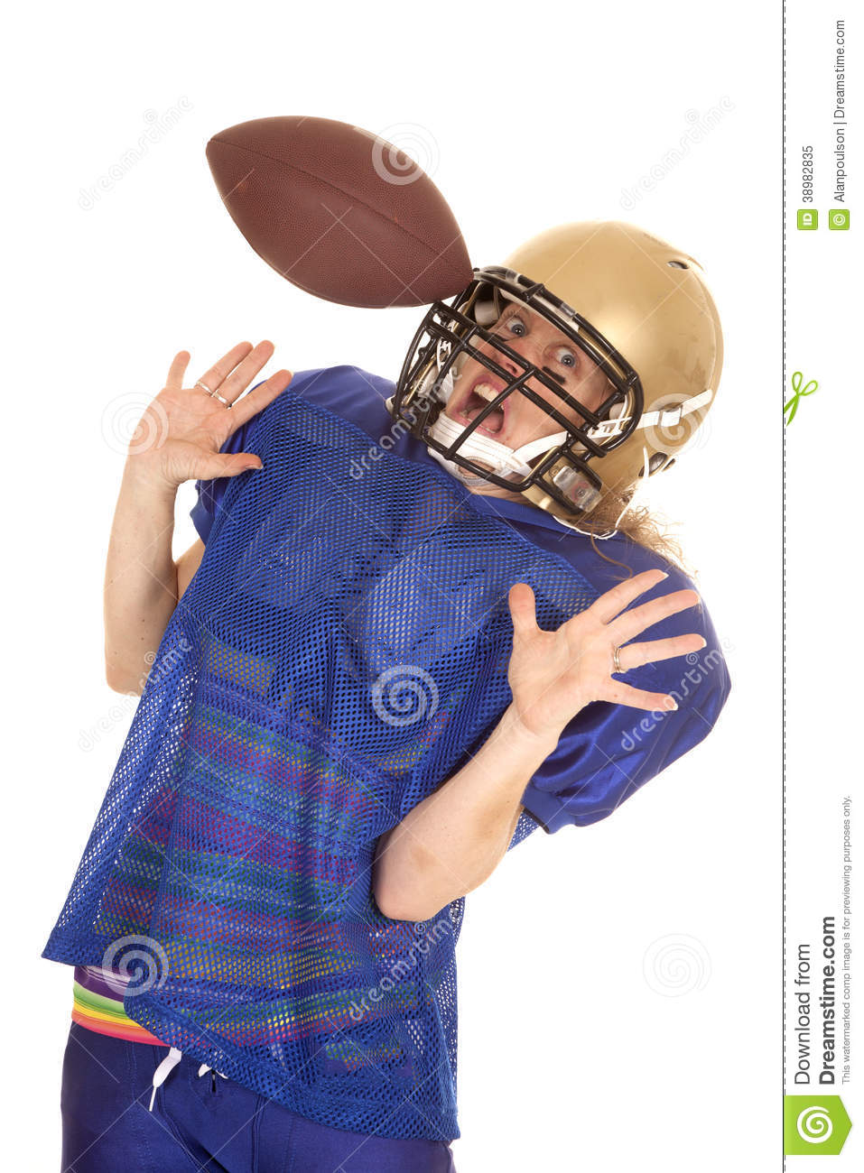 woman football player hit in helmet with ball stock photo