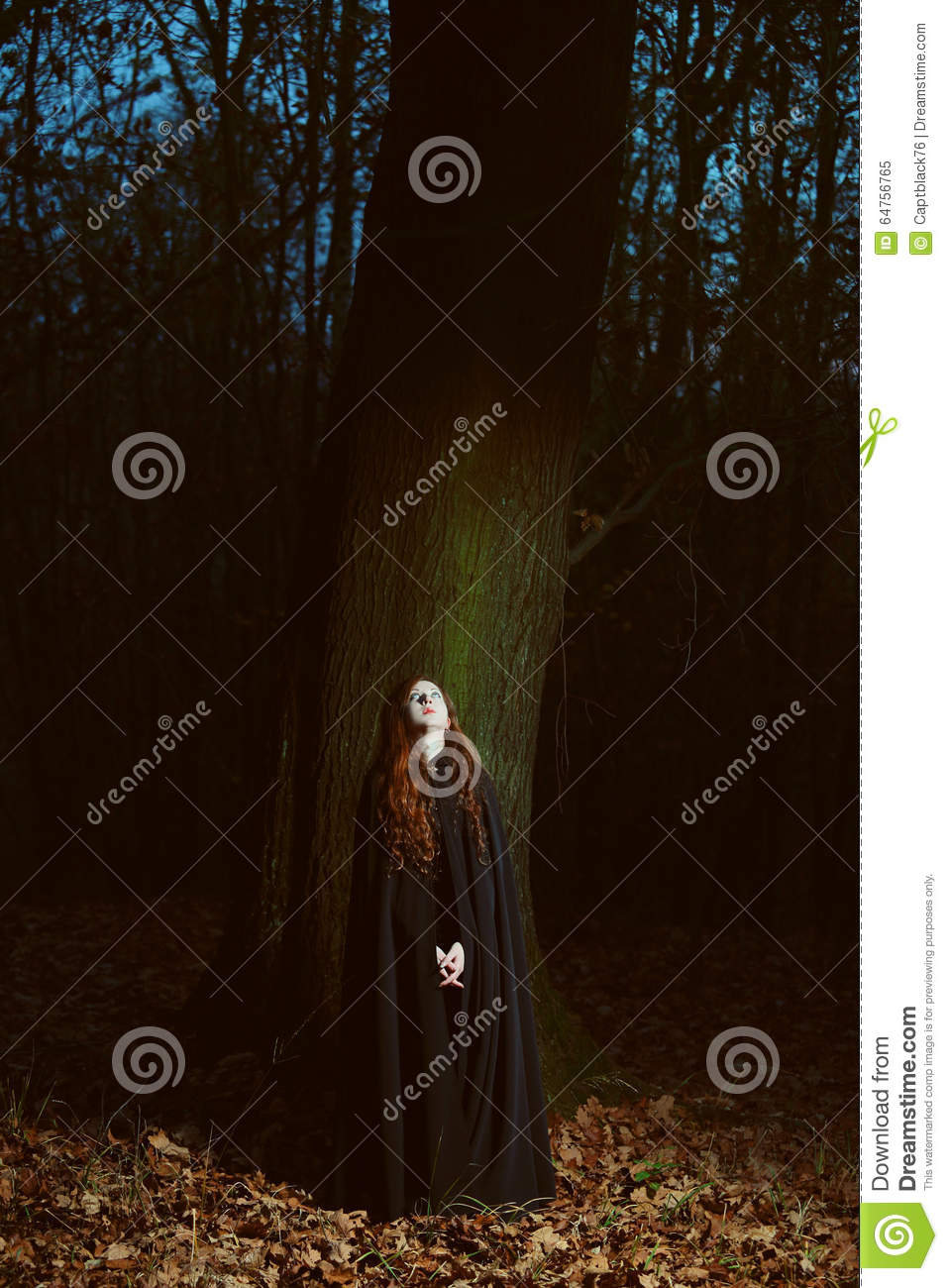 Woman in the forest at night