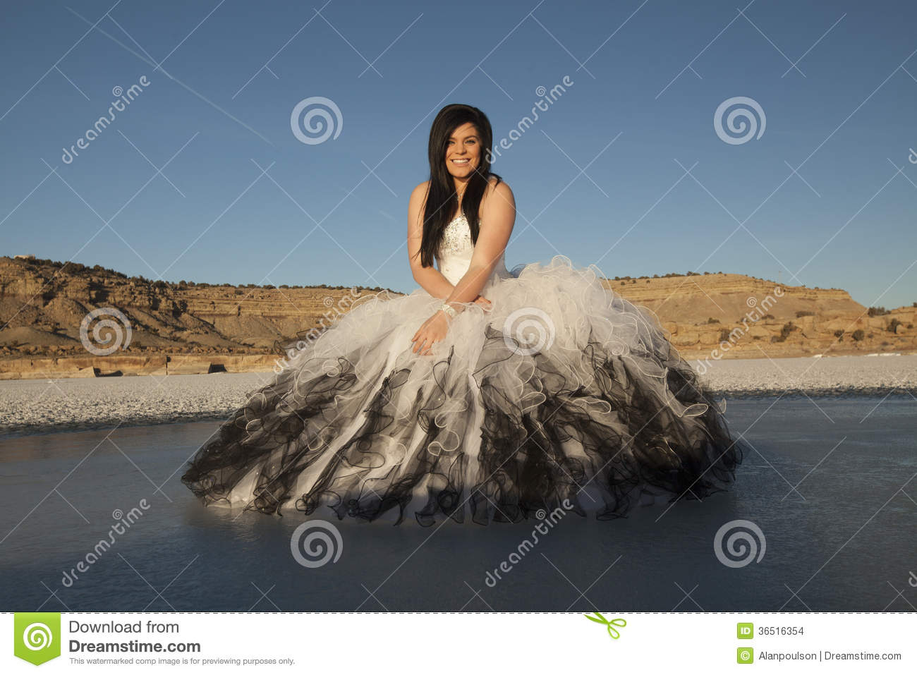 Woman formal dress ice sit smile blue sky