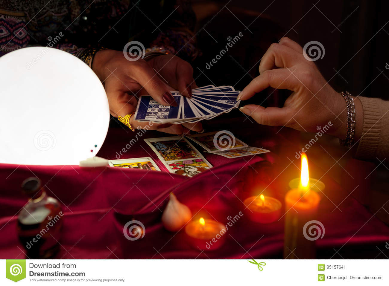 Woman fortune teller holding tarot cards in her hands