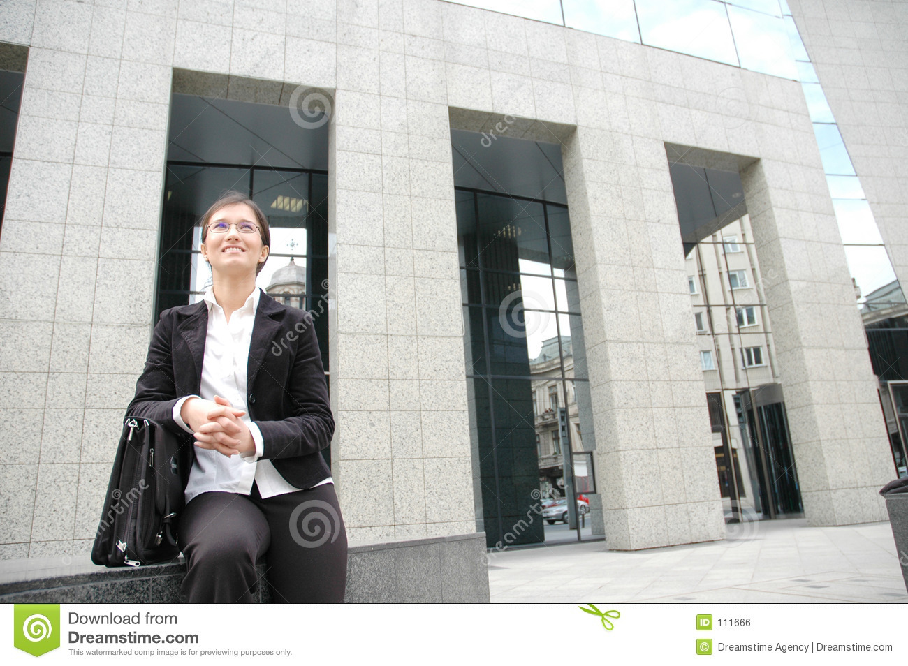 Woman in fron of a corporate building