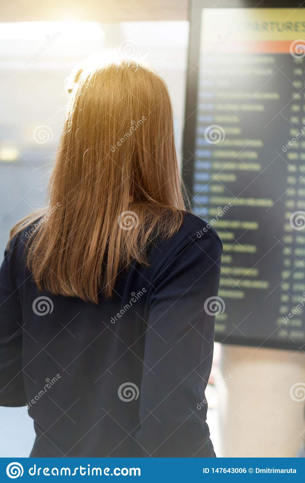 Woman checking her flight.